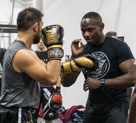 Two men practicing boxing