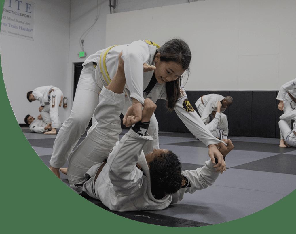 Two people training jiu-jitsu