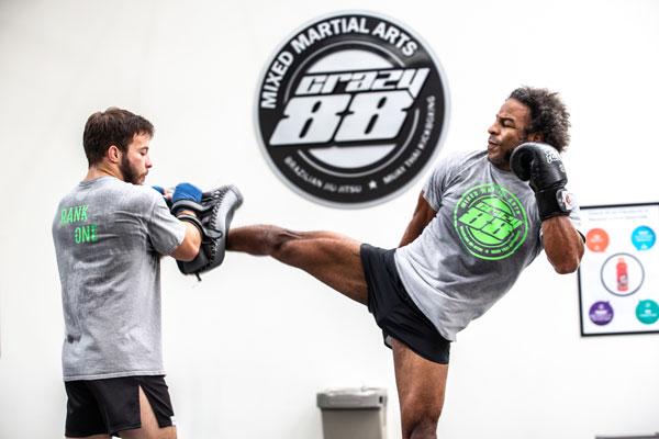 Two men training muay thai